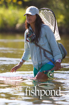 Woman Wading with Fishpond Gear